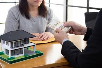 asian-woman-mortgage-home-with-bank-receive-cash-thai-baht_41350-431