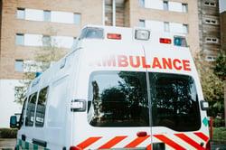 british-ambulance-parked-parking-lot_53876-63438