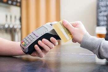 cropped-image-person-paying-with-credit-card_23-2147874447