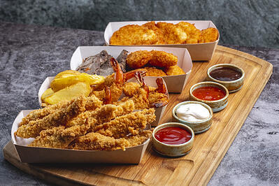 four-boxes-nuggets-with-chicken-prawn-cheese-fish-with-four-sauce_141793-2306