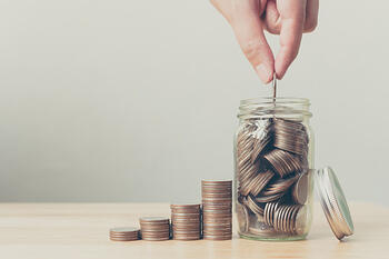 hand-male-female-putting-coins-jar-with-money_20693-58