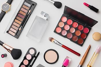 top-view-assortment-with-make-up-palette-perfume_23-2148301875