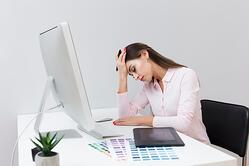 woman-happy-about-work-sitting-desk_23-2148434671