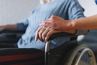 woman-wheelchair-old-age-home_23-2147787985